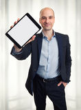 Smiling man holding a tablet Stock Images