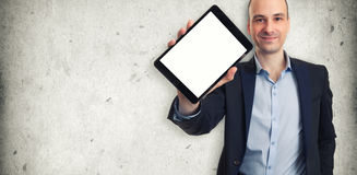 Smiling man holding a tablet with blank screen Royalty Free Stock Photos