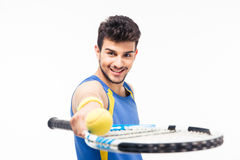 Smiling man holding tennis racket and ball Royalty Free Stock Photos
