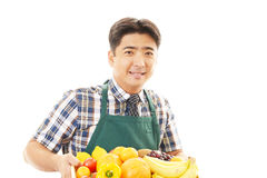 Smiling man holding vegetables with fruits Royalty Free Stock Images