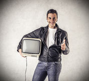 Smiling man holding a vintage television Royalty Free Stock Photo