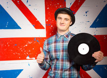 Smiling Man Holding Vinyl Record Showing Thumbs Up Royalty Free Stock Images