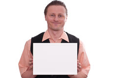 Smiling man is holding a white blank frame Stock Image