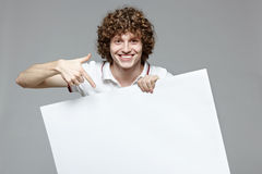 Smiling man holding whiteboard Royalty Free Stock Photo
