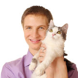 Smiling man holds cat isolated on white Royalty Free Stock Photography