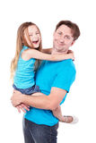 Smiling man holds daughter on hand. Stock Photo