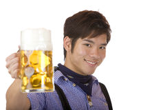 Smiling Man holds Oktoberfest beer stein (Mass) Royalty Free Stock Photos