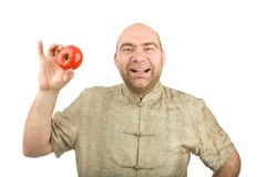 The smiling man holds a tomato Stock Photo