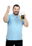 Bartender posing with two beer tankards. Happy smiling bartender posing with two beer tankards on white backgrounds Stock Photography