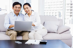 Smiling man at home on couch Stock Photos