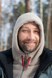 Smiling man in a hood Stock Photo