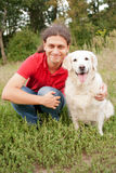 Smiling man hugging a dog Stock Photo