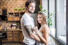 Smiling man hugging woman Royalty Free Stock Image