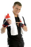 Smiling man indicating bottle Royalty Free Stock Image