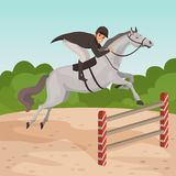 Smiling man jockey on gray horse jumping over hurdle. Male character in equestrian helmet, dark-colored coat and white Royalty Free Stock Image
