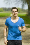 Smiling man jogging Royalty Free Stock Image