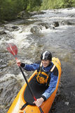 Smiling Man kayaking in river Stock Image