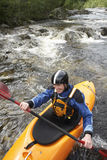 Smiling Man kayaking in river Royalty Free Stock Photos