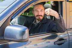 Smiling man with keys as a driver of modern car Stock Photos