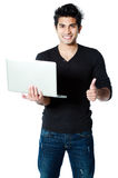 Smiling man with laptop Royalty Free Stock Photo