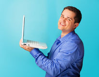 Smiling man with laptop Stock Photos