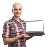 Smiling man with laptop computer Stock Photo