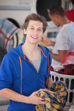 Smiling Man In Laundromat Royalty Free Stock Image