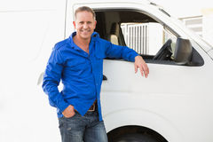 Smiling man leaning against his delivery van Stock Photography