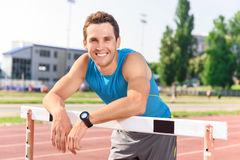 Smiling man leaning on bar Royalty Free Stock Photography