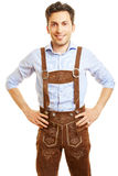 Smiling man in leather pants Stock Photo