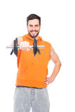 Smiling man lifting dumbbell Royalty Free Stock Image