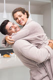 Smiling man lifting and hugging his partner in the morning Royalty Free Stock Photos