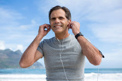 Smiling man listening to music on headphones Stock Photos