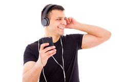 Smiling man looking aside with headphones and mp3 player Royalty Free Stock Photo