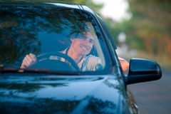 Smiling man looking from a car window Stock Image