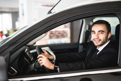 Smiling man looking from a car window Royalty Free Stock Images