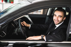 Smiling man looking from a car window Royalty Free Stock Photography