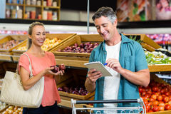 Smiling man looking at the grocery list Royalty Free Stock Photo