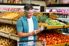Smiling man looking at his list Stock Images