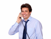 Smiling man looking at you and speaking on phone Stock Image