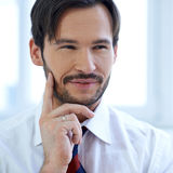 Smiling man lost in thought Royalty Free Stock Image