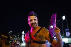 Smiling man with make up at a gay parade at night in the city of Austin, Texas Stock Photos