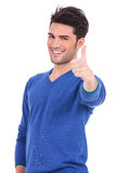 Smiling man making the ok thumbs up sign Stock Photos