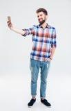 Smiling man making selfie photo on smartphone Royalty Free Stock Photos