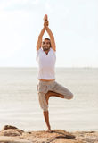 Smiling man making yoga exercises outdoors Royalty Free Stock Photography