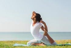 Smiling man making yoga exercises outdoors Royalty Free Stock Photo