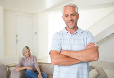 Smiling man with man sitting on couch at home Stock Image