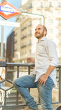 Smiling man by the metro Royalty Free Stock Image