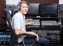 Smiling Man Mixing Audio In Recording Studio Stock Photography