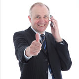 Smiling man on mobile giving thumbs up Royalty Free Stock Photos